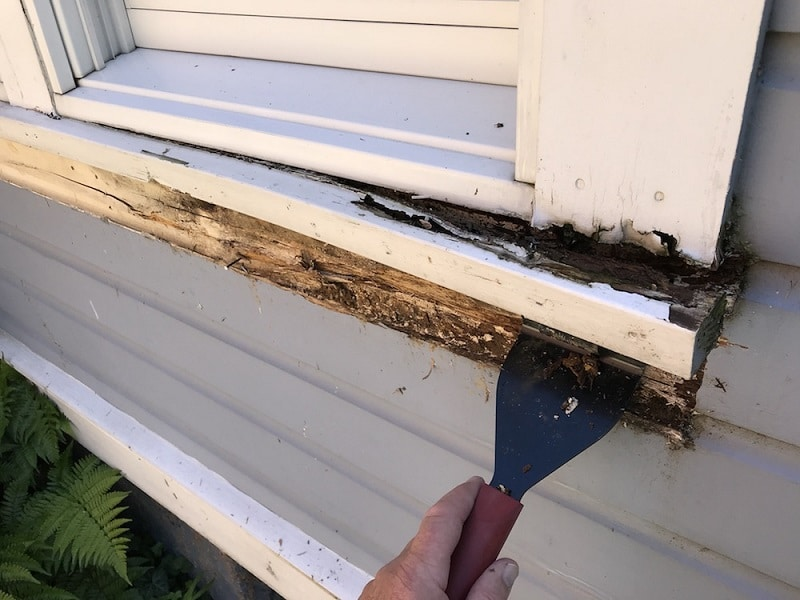 old sill removing with a hammer